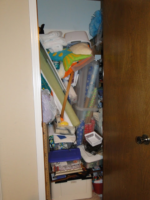 Cramped hallway closet full of stuff