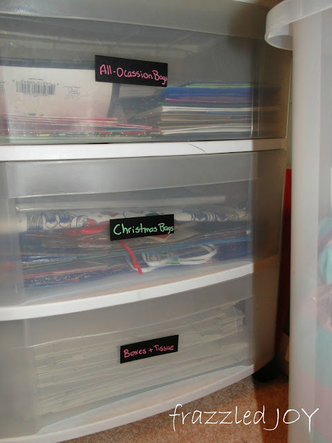 gift wrap supplies organized in large clear plastic drawers