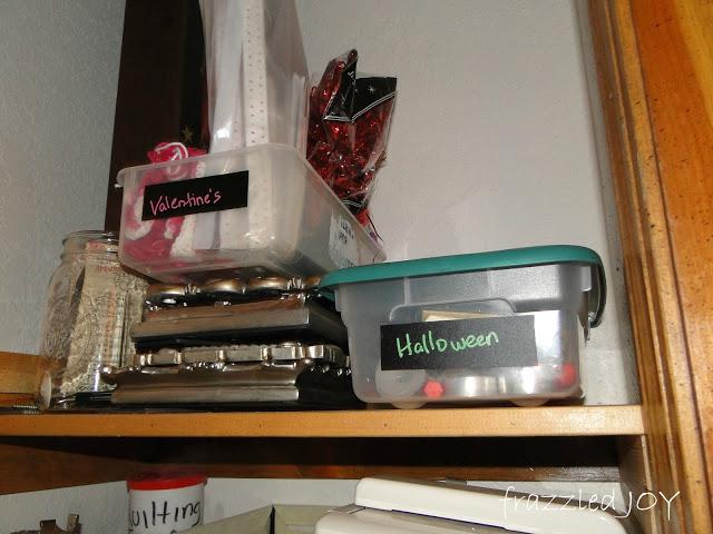 Smaller seasonal decor items stored in plastic tubs