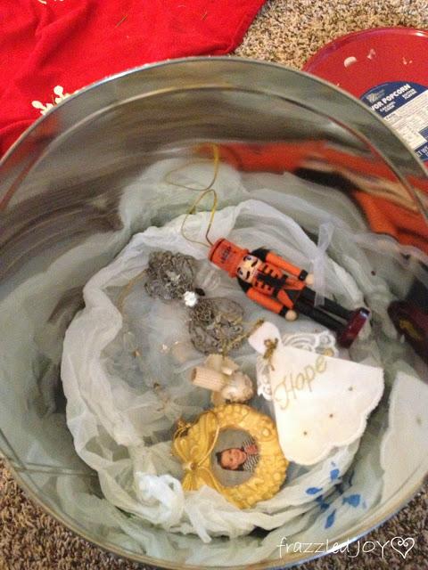 Storing ornaments in old popcorn tins