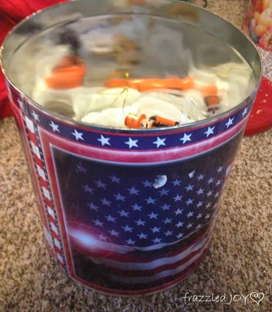 Inexpensive ornament storage using old popcorn tins