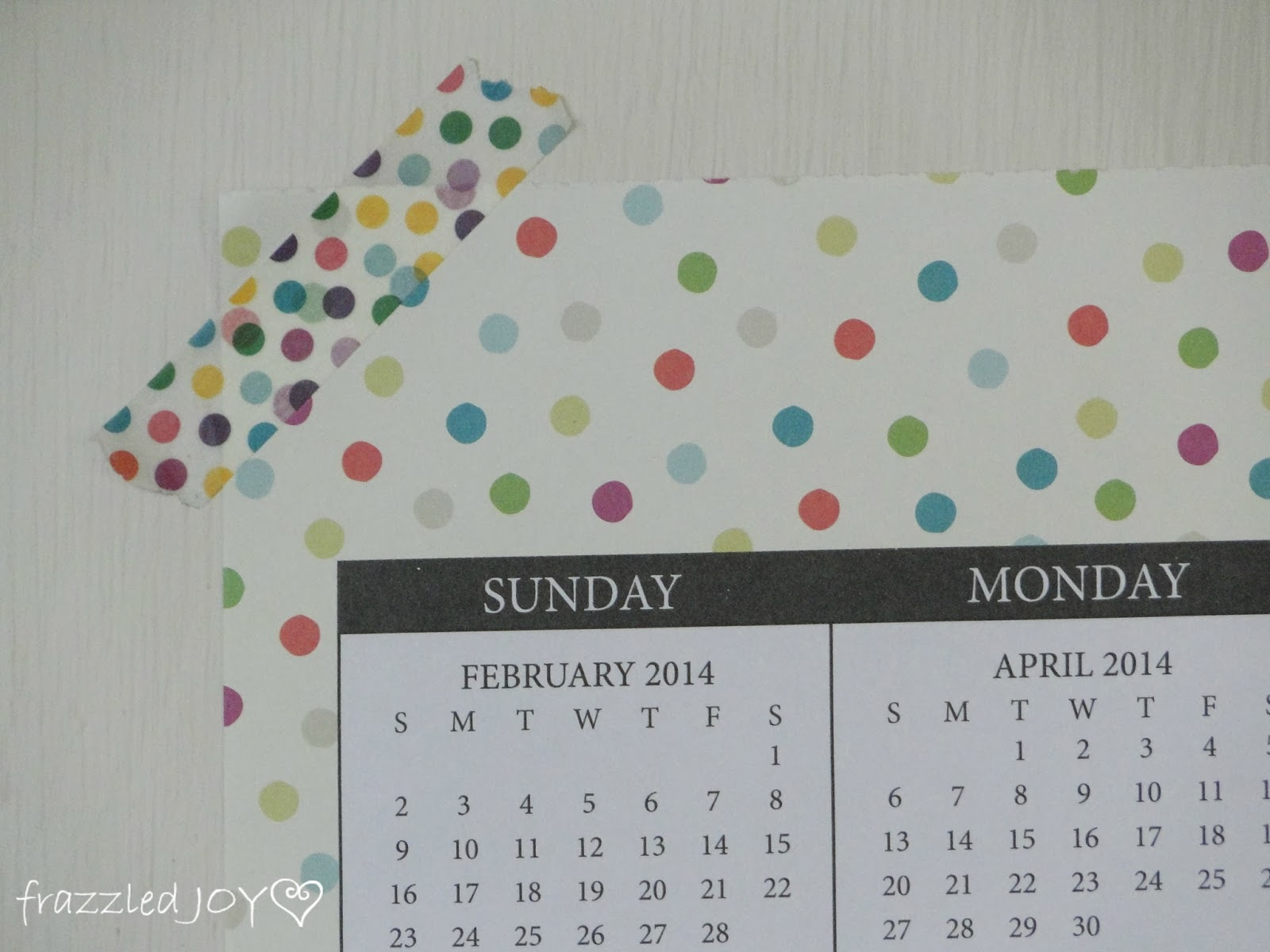 Washi tape is a great damage free way to hang calendars or other papers on the wall.