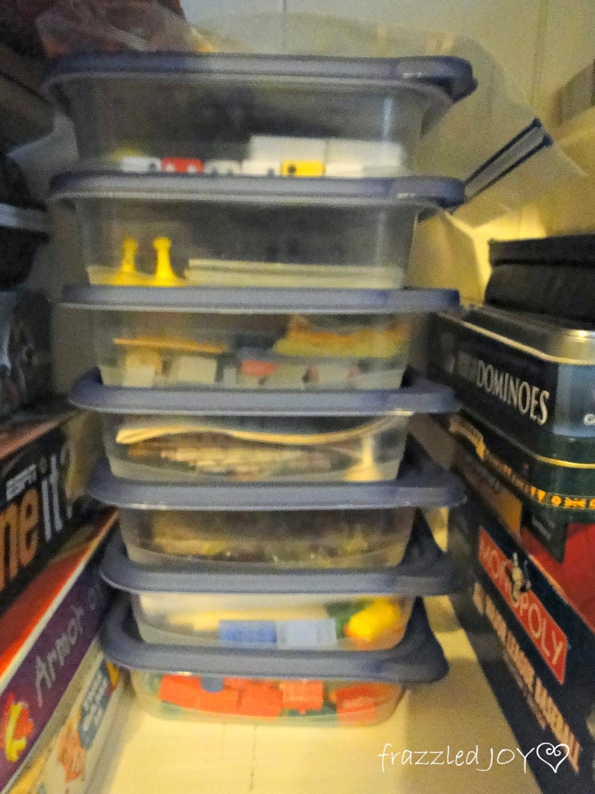 Use clear plastic bins to store and organize board game pieces