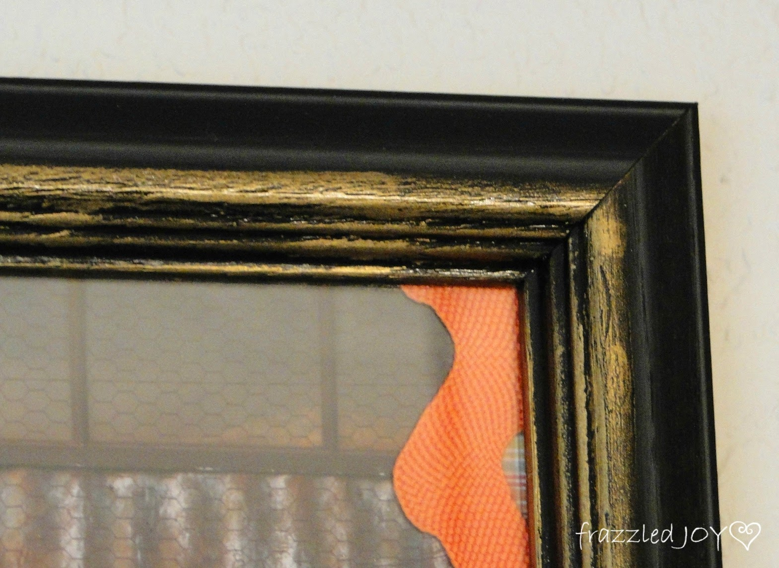 frame painted black with rub n buff accents