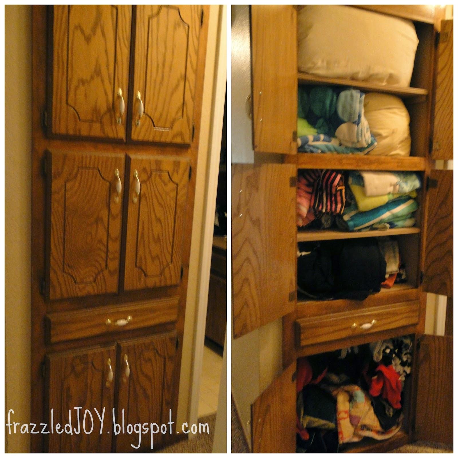 Cramped and unorganized linen closet.