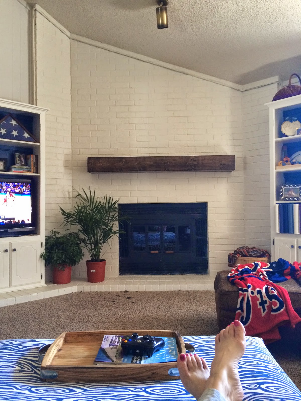 updated fireplace with painted brick and floating mantel