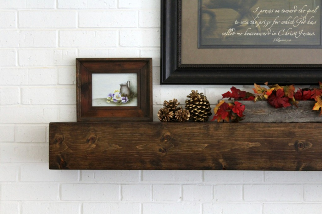 gold-pine-cones-on-mantel