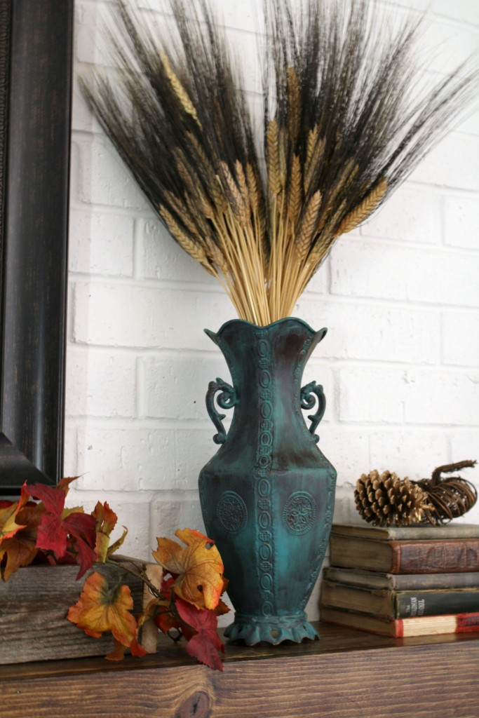 torquoise-vase-with-wheat-on-mantel