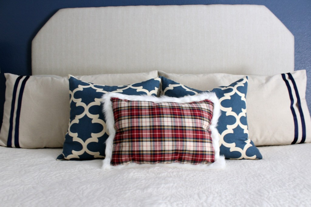 bed-with-red-plaid-pillow