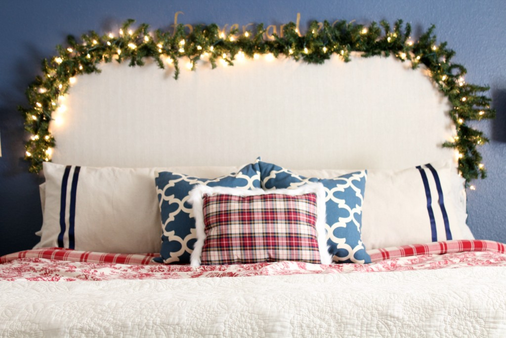greenery hung around headboard at Christmas