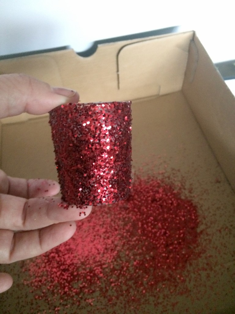 Two coats of glitter covers the candle holder.