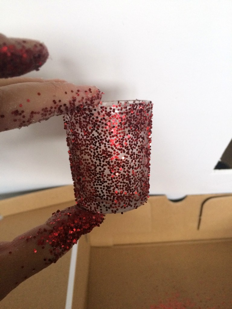One light sprinkle of glitter on candle holder.