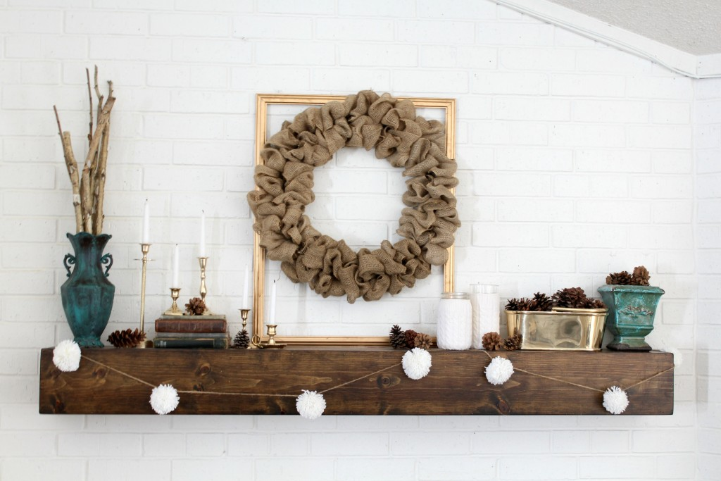 A neutral winter mantel with a few pops of color and shine.