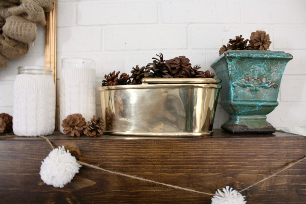 DIY pom poms add a little whimsy to a winter mantel.