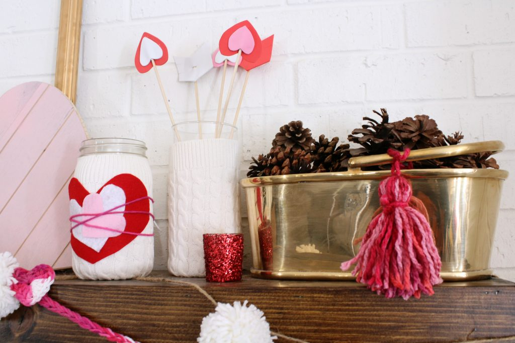 Felt hearts decorate this sweater vase.