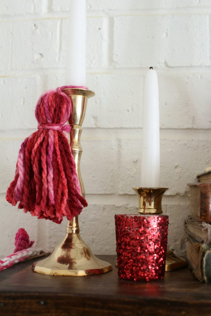 Tassels and glitter help make this mantel fancy and festive.
