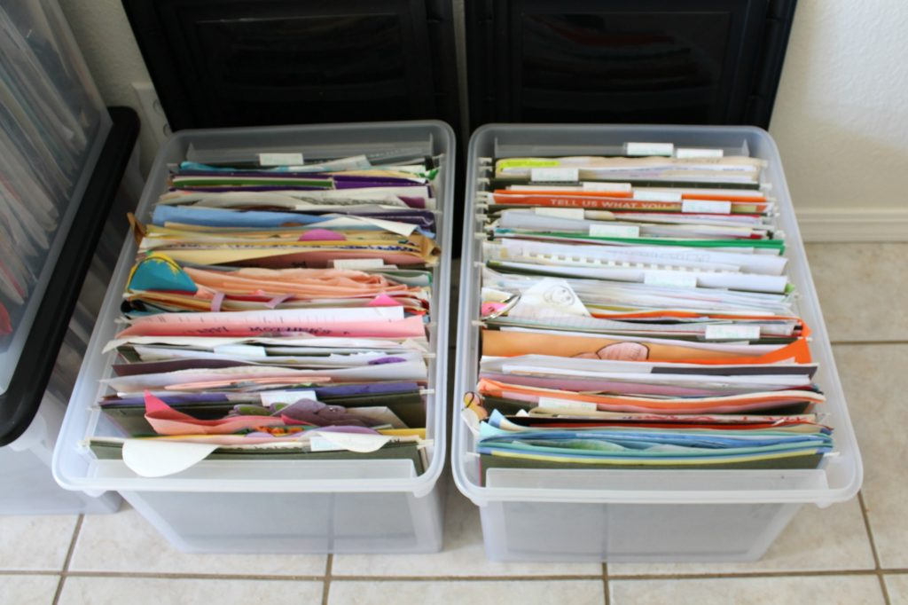 File boxes used to organize school papers by grade and year