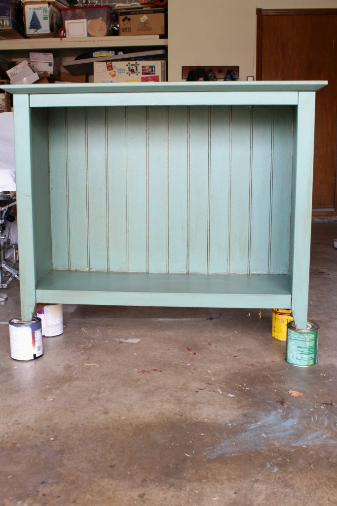 painted bookshelf with DIY chalk paint and creme wax