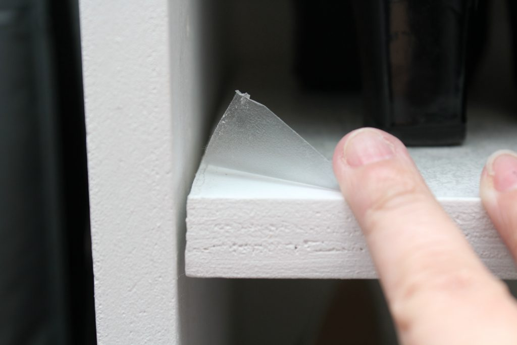 use clear contact paper to protect shelves