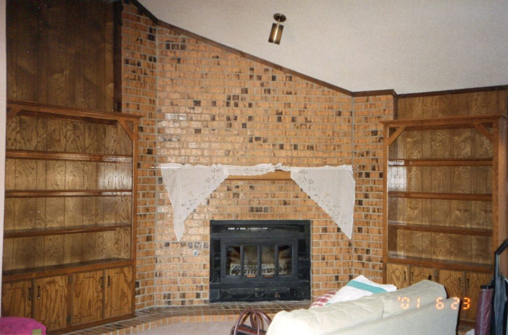 fireplace and surrounding built-ins before