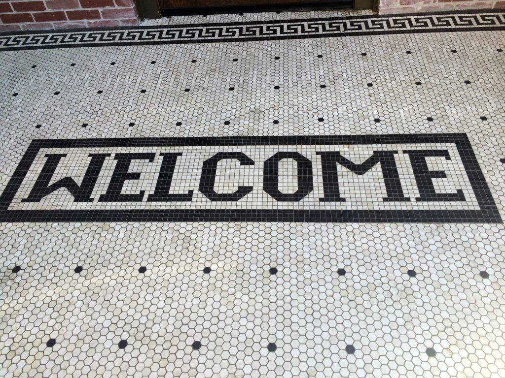 Tile welcome mat outside the Pioneer Woman Mercantile