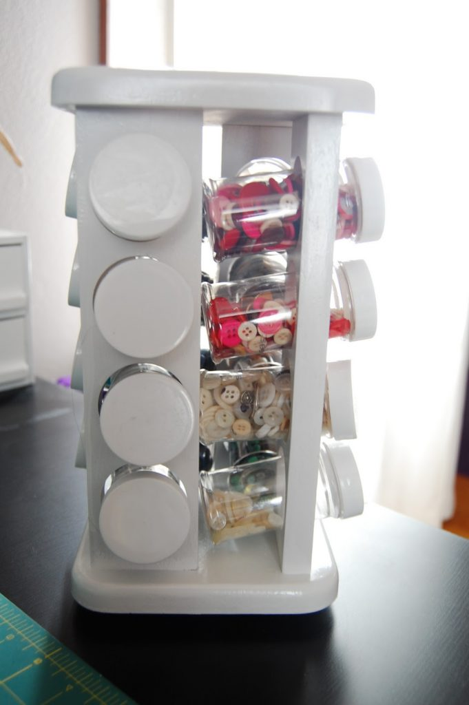 spice rack used to store buttons from Away We Go