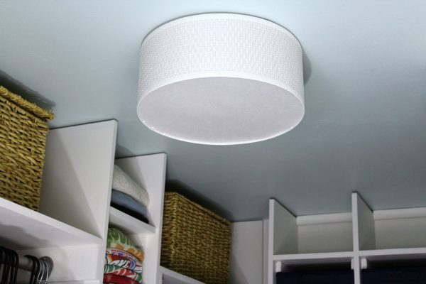 light blue ceiling and ikea light fixture for closet