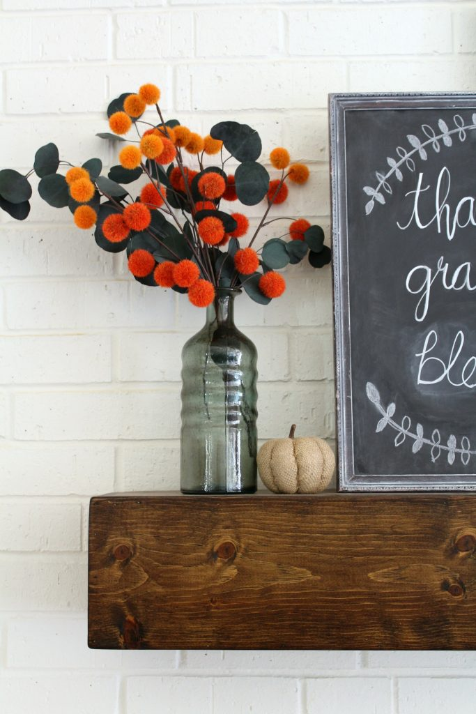 A splash of orange for a fall mantel