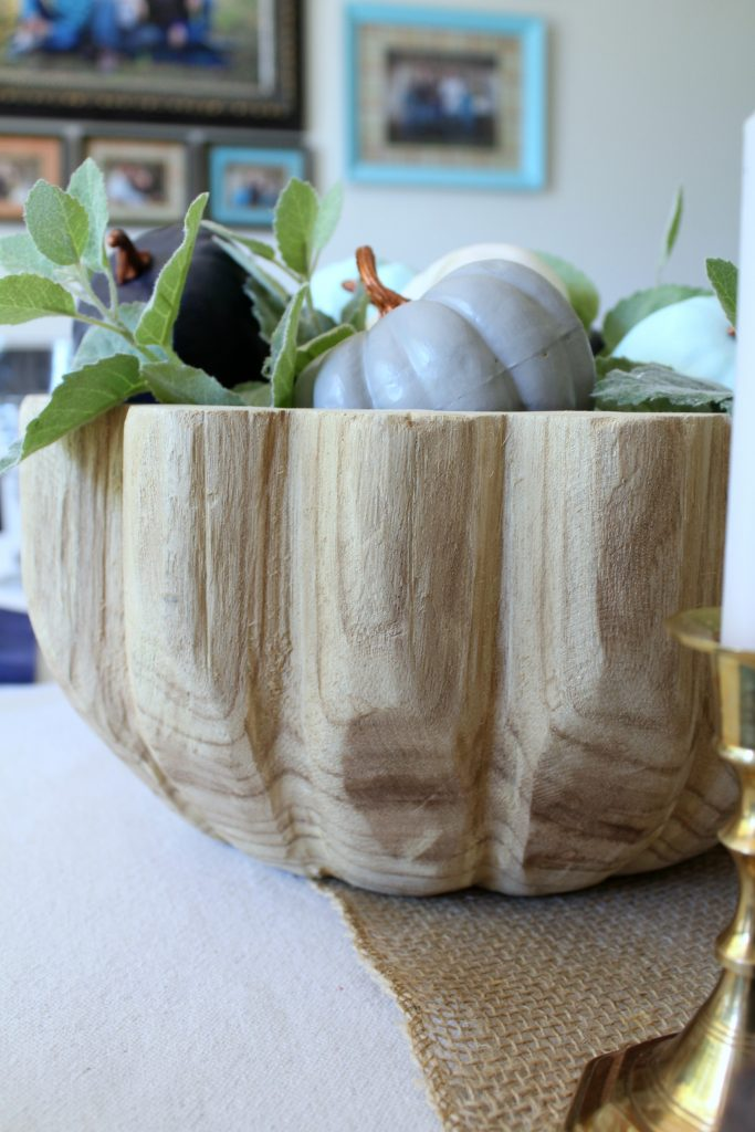 Magnolia wood bowl filled with painted pumpkins