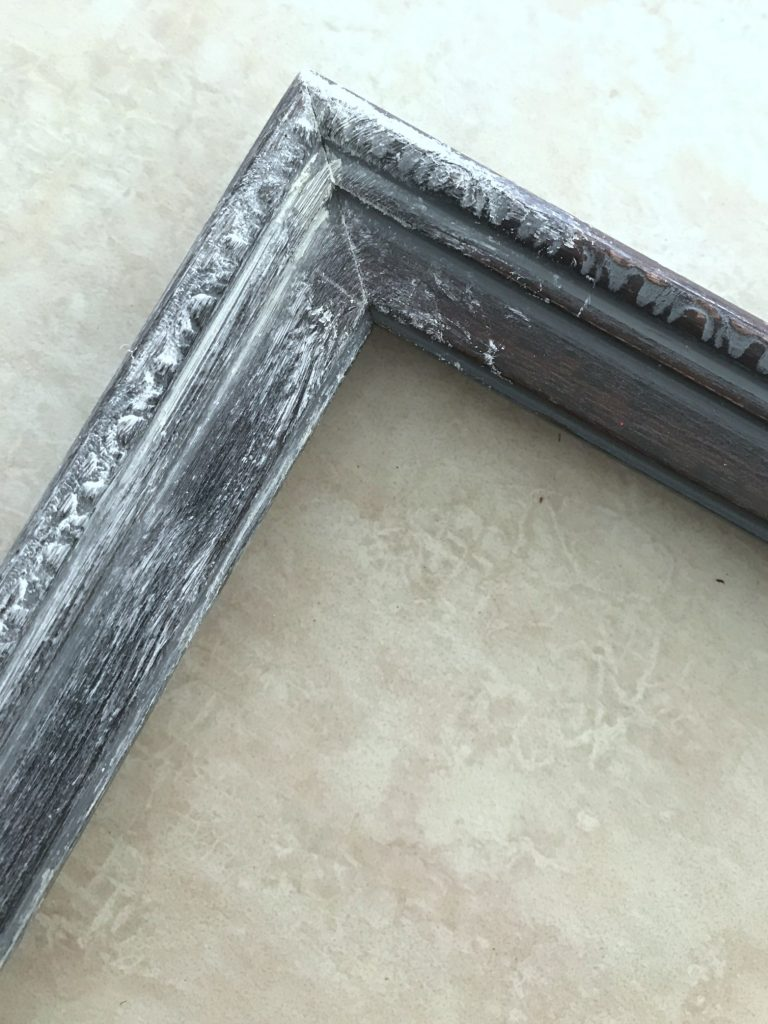 Use white paste wax to age a frame