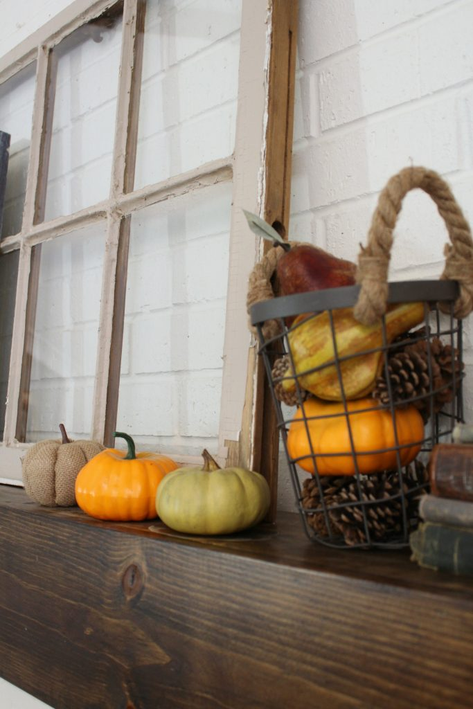 Antique window and pumpkins for fall mantel