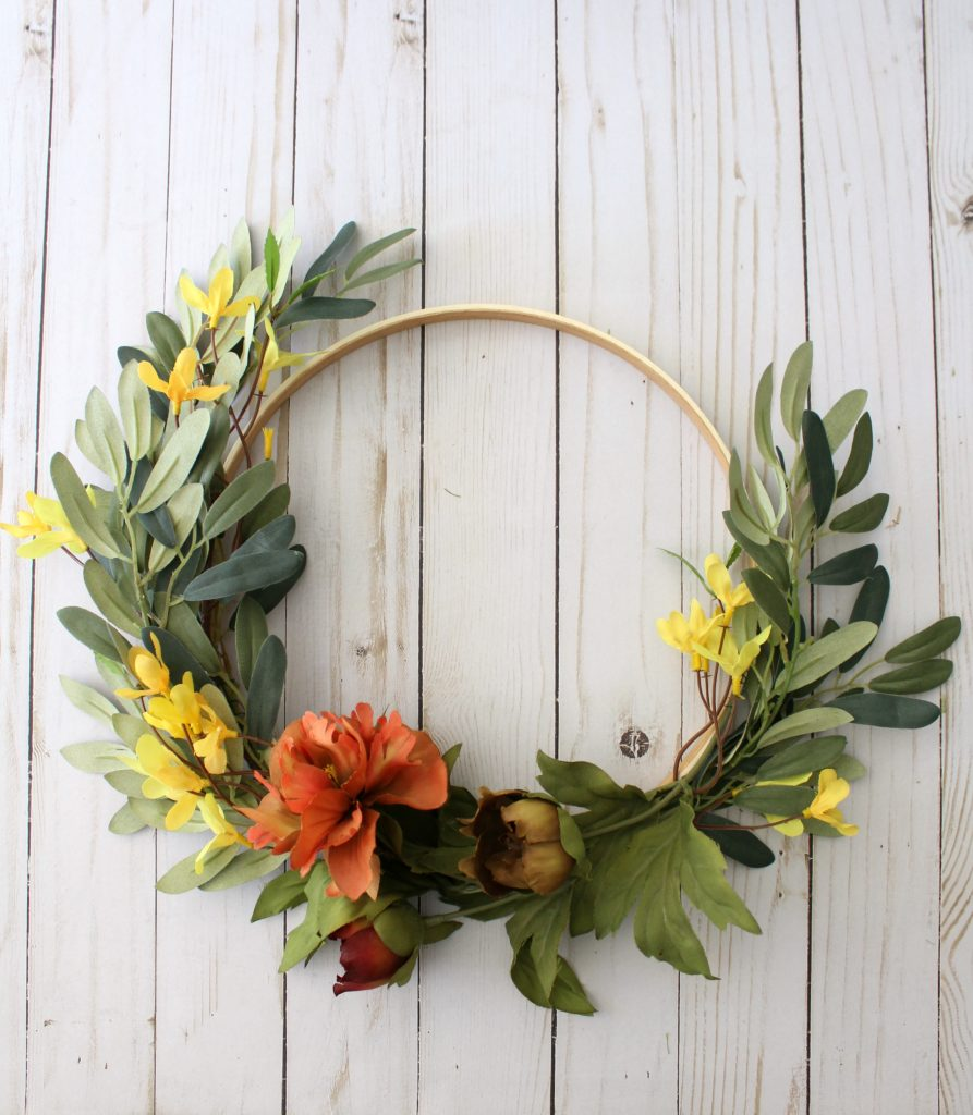 adding faux flowers to your hoop wreath