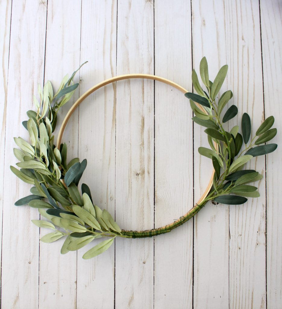 Adding faux greenery to your hoop wreath