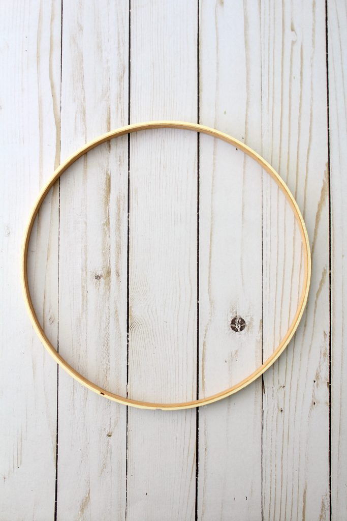 Use solid part of wood hoop for wreath base.