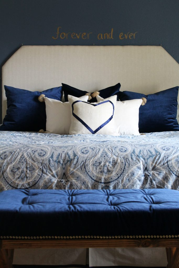 cozy navy and neutral bedding