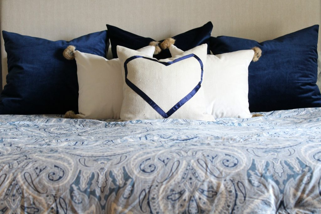 navy and neutral throw pillows