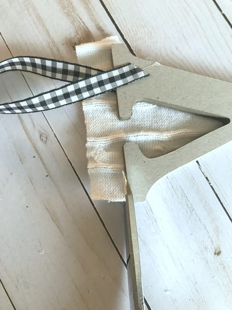 Trim excess fabric from letter