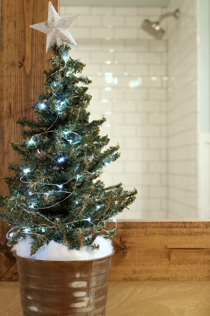 A sweet strand of fairy lights makes this tree sparkle.