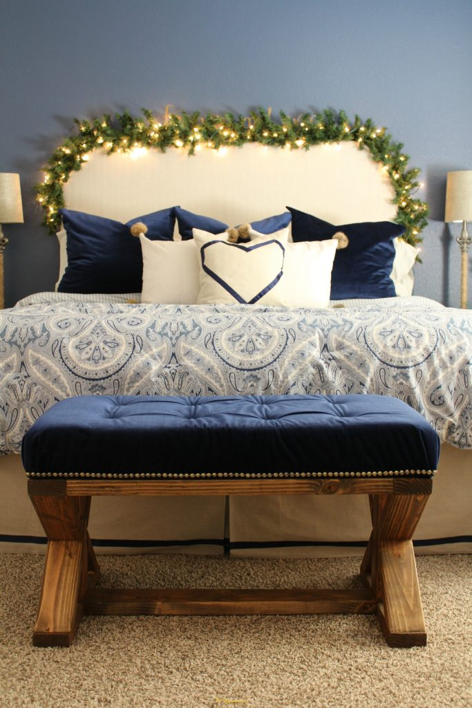 Lighted garland around the headboard makes for a dreamy bedroom