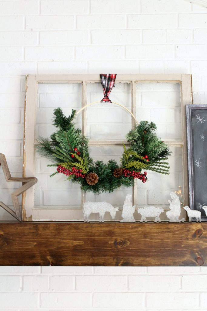 Christmas hoop wreath hung on old window