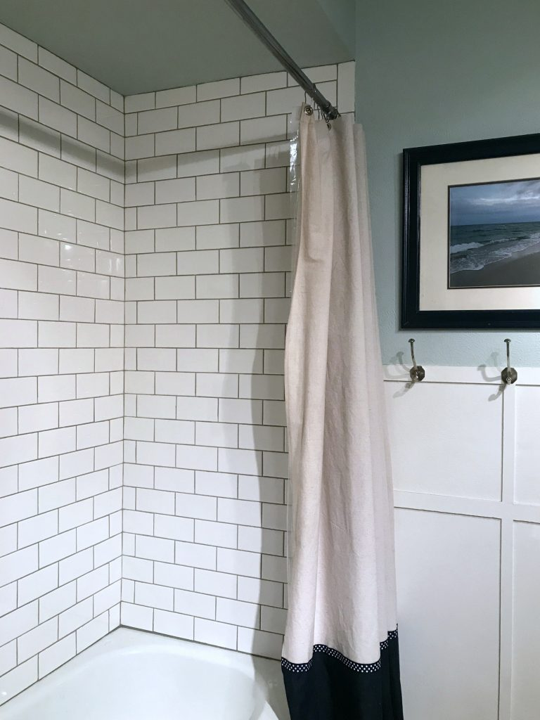 Subway shower tile with light grey grout