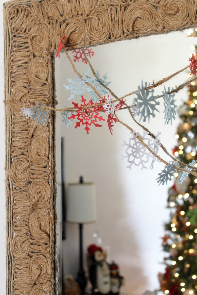 snowflake garland on mirror