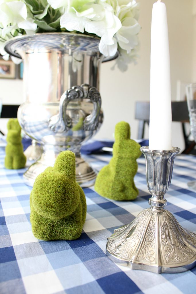 A silver, white and green centerpiece looks greats with the blue and white gingham tablecloth.