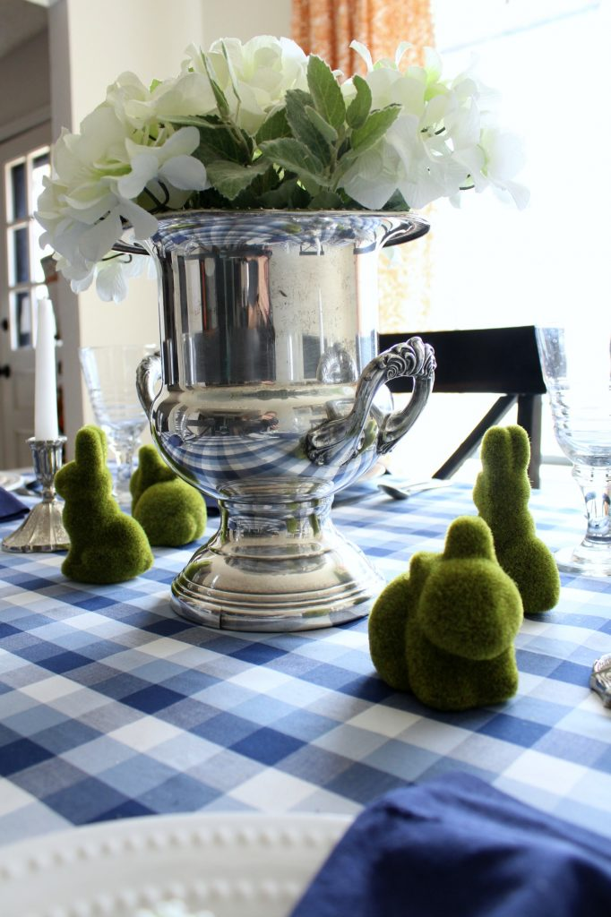 An vintage trophy vase makes a great centerpiece.