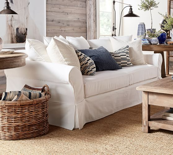 Pottery Barn white slip-covered couch