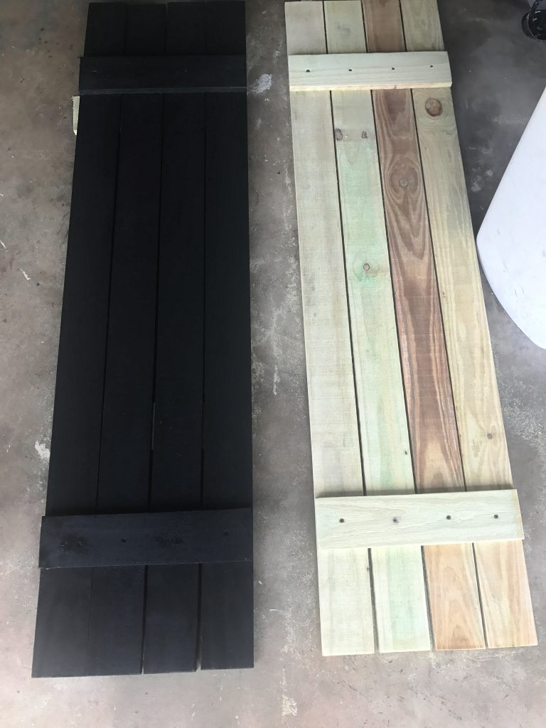 Painted DIY shutters made with fence pickets