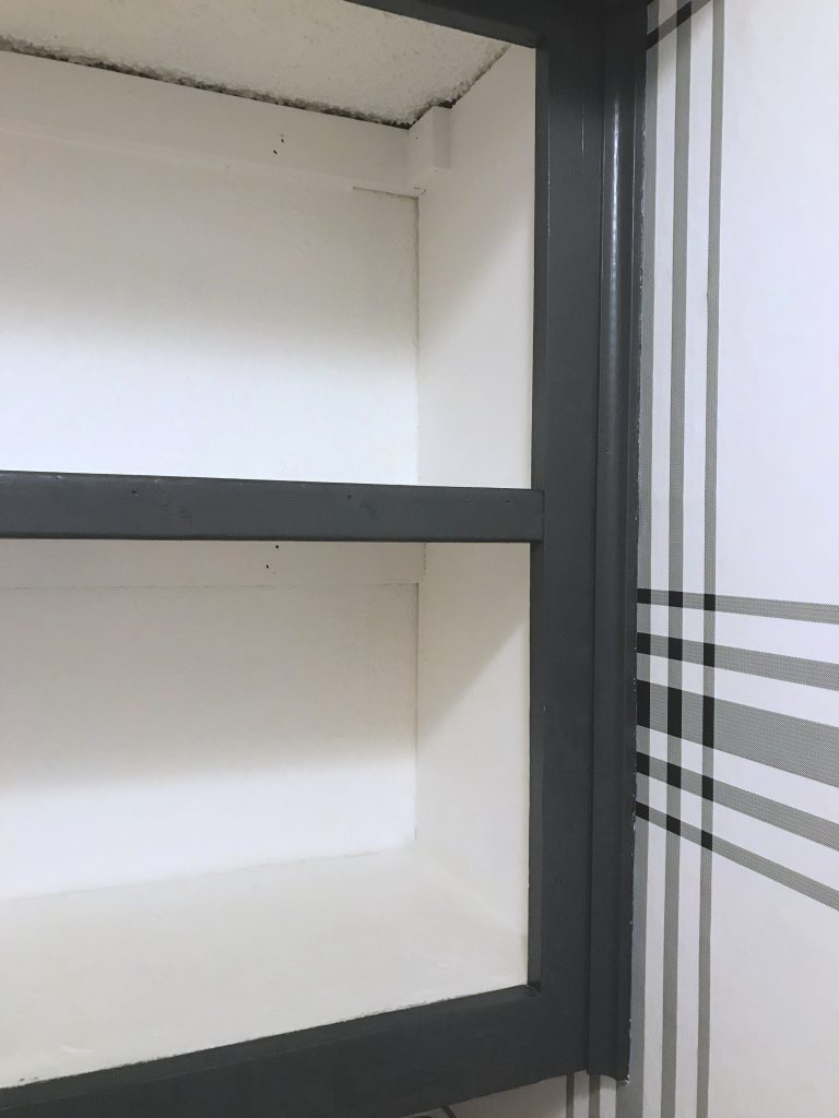 A simple piece of 1X2 made these cabinet look more like built-in shelves