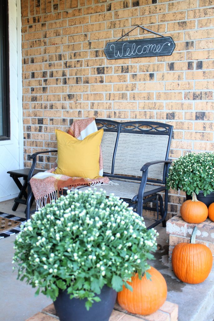 Cozy up your front porch with a throw and a pillow
