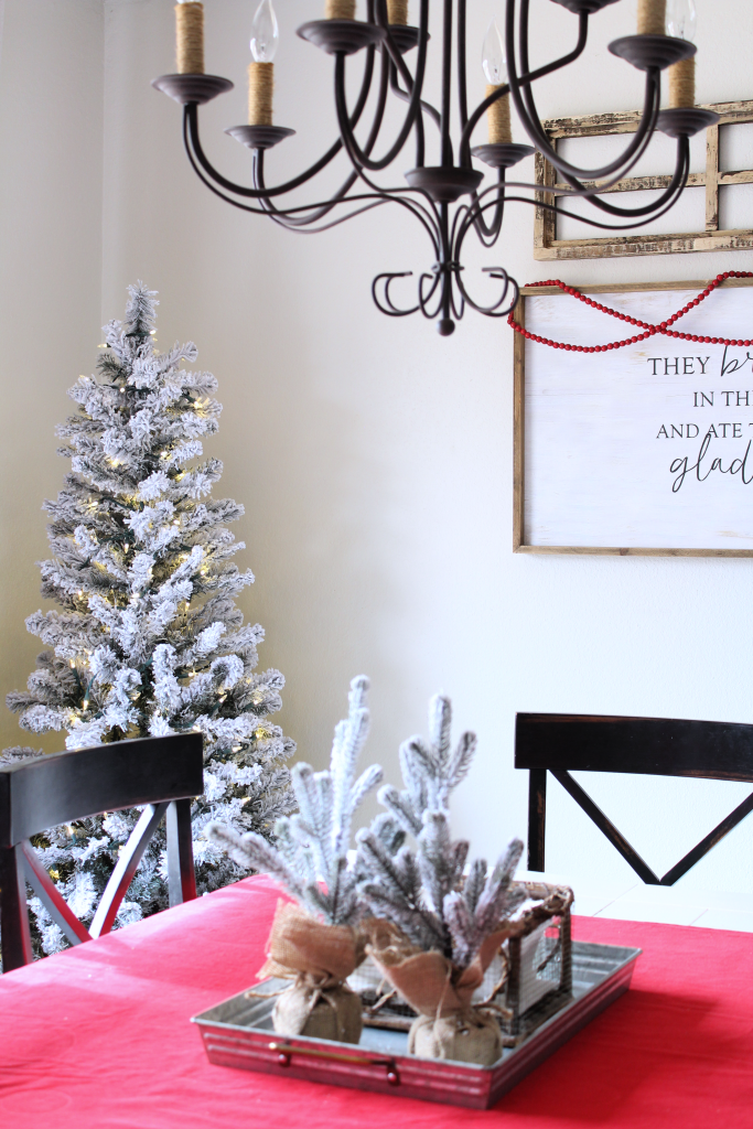 Flocked trees add to the cozy feel in the dining room