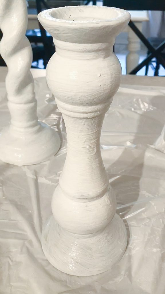 White chalk paint used to update thrifted candlesticks